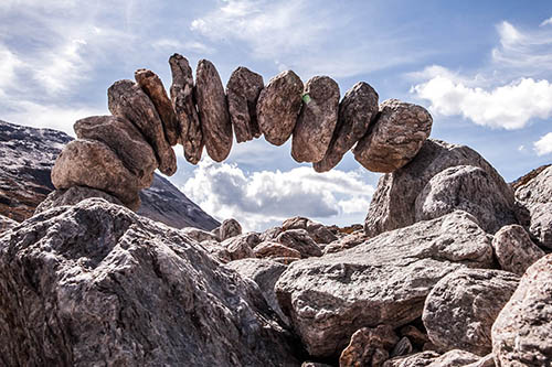 Rocks piled together horizontally to create an arch