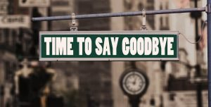 "A street sign that says ""Time to say goodbye""."